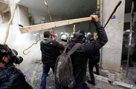 Farmers clash with riot police during a protest outside Agriculture ministry in Athens, Feb. 12, 2016.