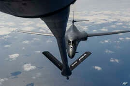 In this image provided by the U.S. Air Force, a B-1B Lancer assigned to the 9th Expeditionary Bomb Squadron, deployed to Andersen Air Force Base, Guam, receives fuel from a KC-135 Stratotanker over the Pacific Ocean March 10, 2017.