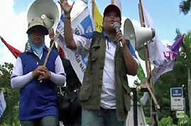 Indonesian union members protesting against a trade agreement with China