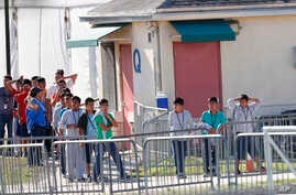 Children line up to enter a tent at the Homestead Temporary Shelter for Unaccompanied Children in Homestead, Fla., Feb. 19, 2019.