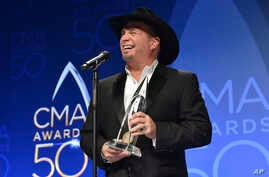 Garth Brooks, winner of the award for entertainer of the year, participates in an interview in the press room at the 50th annual CMA Awards at the Bridgestone Arena in Nashville, Tennessee, Nov. 2, 2016.