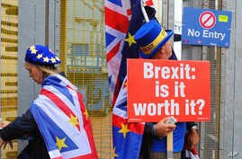Anti-Brexit protesters stand outside the International Convention Center in Birmingham during a Conservative Party Conference at the ICC, in Birmingham, England, Oct. 2, 2018.