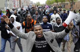 The Rev. Westley West leads a march for Freddie Gray to the Baltimore Police Department's Western District police station, in Baltimore, April 22, 2015.