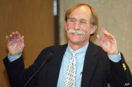 FILE - Dr. Peter Agre, pictured in 2003 after it was announced that he'd been named a Nobel Prize winner, says an effort by North Korea to produce the country's first Nobel Prize-winning scientist would contribute to improved political ties with the