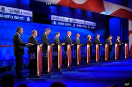 Republican presidential candidates, from left, John Kasich, Mike Huckabee, Jeb Bush, Marco Rubio, Donald Trump, Ben Carson, Carly Fiorina, Ted Cruz, Chris Christie, and Rand Paul take the stage during the CNBC Republican presidential debate at the Un