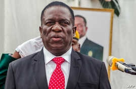 Zimbabwe's new President Emmerson Mnangagwa presides over a swearing in ceremony as his new cabinet took office on Dec. 4, 2017 at State House in Harare.