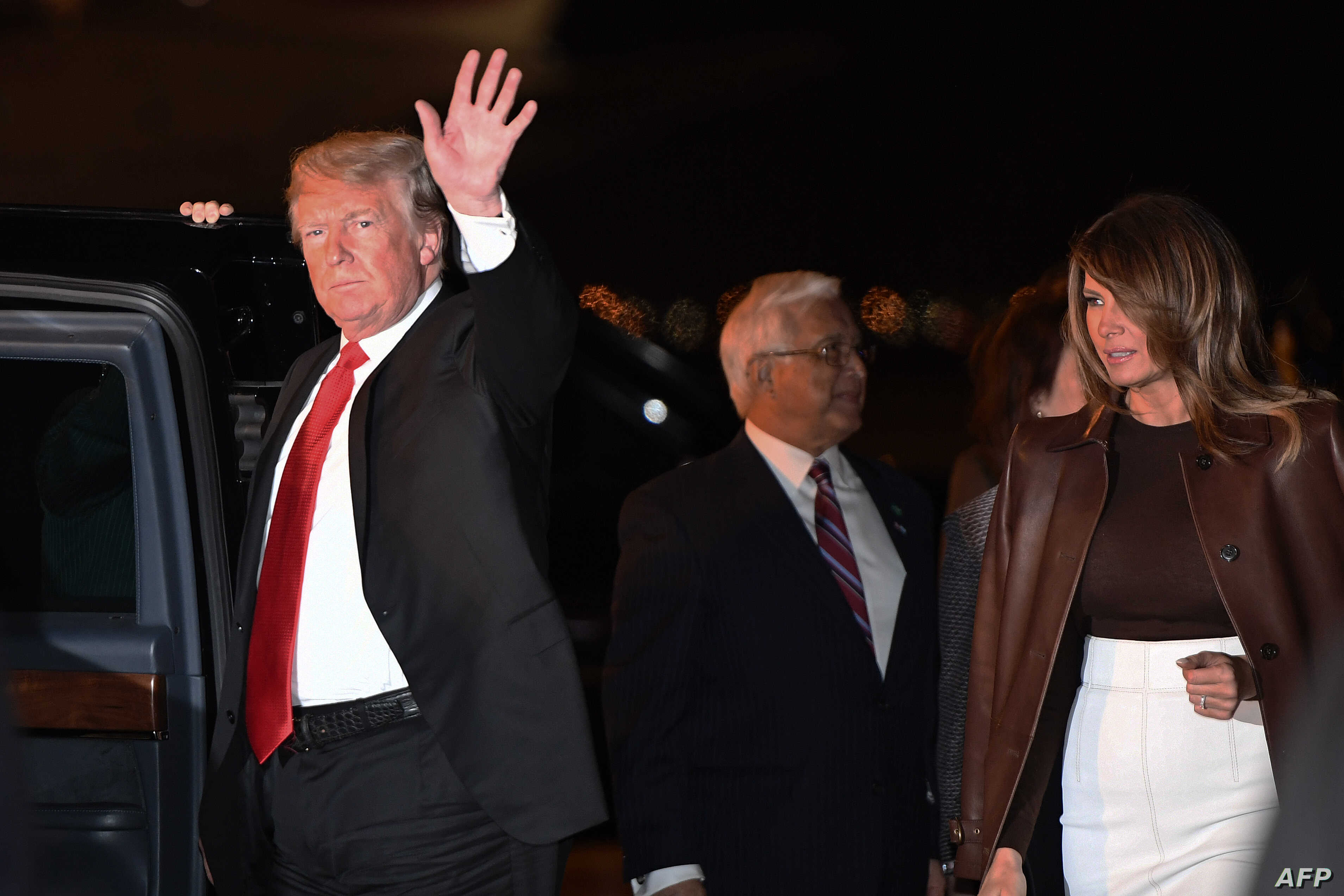U.S. President Donald Trump and first lady Melania Trump disembark from Air Force One upon arrival at Ezeiza International Airport in Buenos Aires, Argentina, Nov. 29, 2018, as they travel to attend the G20 summit.