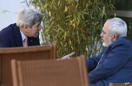 U.S. Secretary of State John Kerry, left, talks with Iranian Foreign Minister Mohammad Javad Zarif, in Geneva, Switzerland, May 30, 2015.