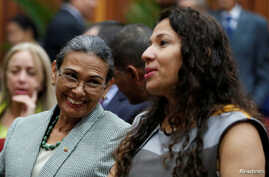 Socorro Hernandez (left) and Tania D' Amelio talk during their swearing in ceremony as new board members of the National Electoral Council, at the Supreme Court in Caracas, Venezuela Dec. 14, 2016.