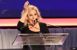 FILE - Bette Midler speaks at 15th Annual Movies for Grownups Awards at the Beverly Wilshire Hotel, Feb. 8, 2016, in Beverly Hills, California.