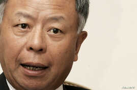 FILE - Then-Vice President of Asian Development Bank Jin Liqun speaks during an interview with Reuters in Islamabad.