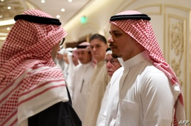Salah Khashoggi, right, the son of murdered Saudi journalist Jamal Khashoggi, and his relatives receive mourners at an events hall in the Saudi coastal city of Jeddah, Nov. 16, 2018.
