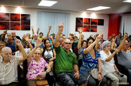 FILE - Neighborhood residents vote during the nominations for candidates for municipal assemblies in Havana, Cuba, Oct. 12, 2017.