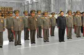 North Korea defense commission vice chairman Jang Song Taek is seen in a dark brown uniform third from left in the first row at a ceremony in Pyongyang, September 9, 2012. (Rodong Sinmun photo)