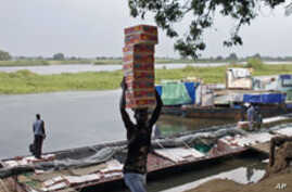 Barges Bring Jubilant Returnees to South Sudan