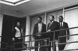FILE - In this Apr. 3, 1968 file photo, the Rev. Martin Luther King Jr. stands with other civil rights leaders on the balcony of the Lorraine Motel in Memphis, Tenn., a day before he was assassinated at approximately the same place. From left are Hos
