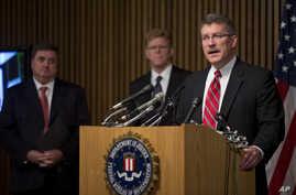 """Ron Hosko, assistant director of the FBI's Criminal Investigative Division, right, speaks during a news conference at FBI headquarters in Washingotn, Monday, July 29, 2013,  about """"Operation Cross Country."""""""