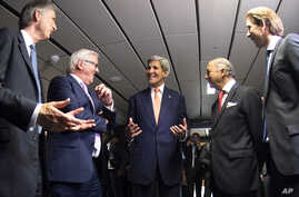 French Foreign Minister Laurent Fabius, second right, German Foreign Minister Frank-Walter Steinmeier, second left, British Foreign Secretary Philip Hammond, left, US Secretary of State John Kerry, center, and Austria's Foreign Minister Sebastian Kur