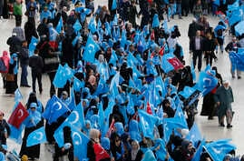 People from the Uighur community living in Turkey carry flags of what ethnic Uighurs call 'East Turkestan', during a protest in Istanbul, Tuesday, Nov. 6, 2018, against what they allege is oppression by the Chinese government to Muslim Uighurs in far