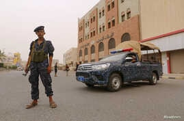 A pro-Houthi police trooper stands past a patrol vehicle in the Red Sea port city of Hodeidah, Yemen, June 14, 2018.