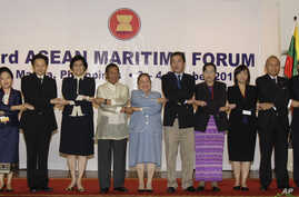 Philippine Vice President Jejomar Binay, 7th from left, joins hands with Association of Southeast Asian Nations (ASEAN) officials at the opening of the 3rd ASEAN Maritime Forum in Manila, Philippines, Oct. 3, 2012.
