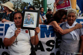 Mother of Jeisson Chavarria, who was killed in a recent protest over reforms of pension plans of Nicaraguan Social Security Institute (INSS), holds a photo during a protest organized by the Mothers of April Movement to demand from President Daniel Or