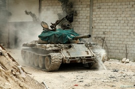 A military vehicle that belongs to the Free Syrian Army is seen in Al-Amariya district in Aleppo, May 8, 2014.