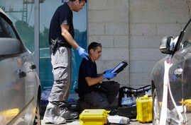 Israeli police investigates at the scene of an stabbing attack in the West Bank settlement of Gush Etzion, Sept. 15, 2018.