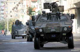 Members of Turkish police special forces in armored vehicles take part in a security operation in Diyarbakir, Turkey, October 26, 2015. Two Turkish policemen and seven Islamic State militants were killed in a firefight after police raided more than a