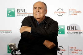 FILE - Director Bernardo Bertolucci poses for photographers during a photo call at the Rome Film festival in Rome, Oct. 15, 2016.