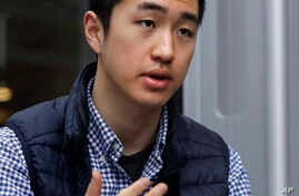 Harvard University graduate Jin K. Park, who holds a degree in molecular and cellular biology, gestures during an interview in Cambridge, Mass., Thursday, Dec. 13, 2018. (AP Photo/Charles Krupa)