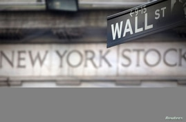 A Wall Street sign is pictured outside the New York Stock Exchange in New York, Oct. 28, 2013.