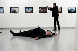 Russian Ambassador to Turkey Andrei Karlov lies on the ground after he was shot by Mevlut Mert Altintas at an art gallery in Ankara, Turkey, Dec. 19, 2016.