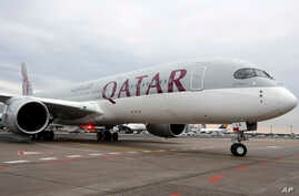 FILE- A Qatar Airways Airbus A350 approaches the gate at the airport in Frankfurt, Germany.