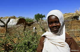 Khadieja Omer Mohamed, a 4th grader at Sudan Aid School at Dereige camp for the internally displaced poses for a photograph in Nyala in South Darfur, Sudan, Nov. 19, 2015.