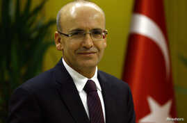 FILE - Turkish Deputy Prime Minister Mehmet Simsek poses during an interview with Reuters in Ankara, Turkey, Dec. 23, 2015.