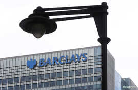 FILE - A security camera is seen near a Barclay bank office at Canary Wharf  in London, Britain May 19, 2015.