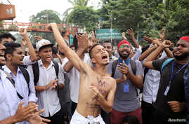 Students shout slogans as they take part in a protest over recent traffic accidents that killed two students, in Dhaka, Bangladesh, Aug. 4, 2018.
