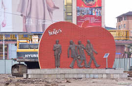 A statue of the Beatles stands,  Aug. 9, 2017, in Mongolia's capital, Ulaanbaatar. It could be moved or demolished if development of the site goes forward.