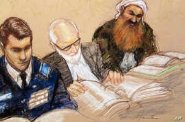 A sketch by a courtroom artist shows self-proclaimed terrorist mastermind Khalid Sheikh Mohammed, right, as he reviews court documents with his lawyers during the pre-trial hearing at the Guantanamo Bay U.S. Naval Base in Cuba, Feb. 12, 2013.