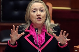 FILE - In this Thursday, Nov. 1, 2012 file photo, Secretary of State Hillary Rodham Clinton makes a speech at the Parliament in the capital Tirana, Albania. Alarmed that rebel militias could be profiting from a sharp increase in the poaching of eleph