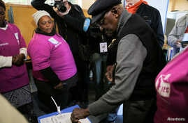 Archbishop Emeritus Desmond Tutu casts his vote during the local government elections in Milnerton, Cape Town, South Africa, Aug. 3, 2016.
