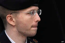 Army Pfc. Bradley Manning is escorted into a courthouse in Fort Meade, Md., Aug. 21, 2013, before a sentencing hearing in his court martial.