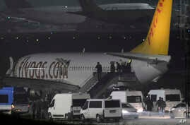 Passengers of private Turkish company Pegasus leave the plane at the Sabiha Gokcen Airport in Istanbul, Turkey, Feb. 7, 2014.