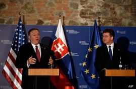 Slovak Foreign Minister Miroslav Lajcak, right, and U.S. Secretary of State Mike Pompeo address the media during a press conference in Bratislava, Slovakia, Feb. 12, 2019.