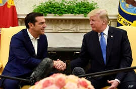 President Donald Trump, right, shakes hands with Greek Prime Minister Alexis Tsipras in the Oval Office of the White House in Washington, Oct. 17, 2017.