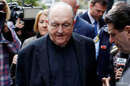 FILE - Archbishop Philip Wilson leaves Newcastle Local Court, in Newcastle, Australia, July 3, 2018.