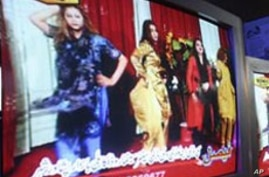 Show featuring dancing women on a TV screen in a shop, Kabul, Afghanistan, Jan. 22, 2009 (file photo).