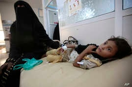 A girl is treated for suspected cholera infection at a hospital in Sanaa, Yemen, Jul. 1, 2017.