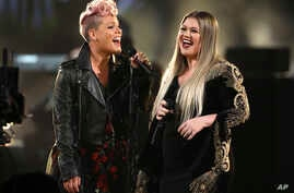 "Pink, left, and Kelly Clarkson perform ""Everybody Hurts"" at the American Music Awards at the Microsoft Theater on Sunday, Nov. 19, 2017, in Los Angeles."